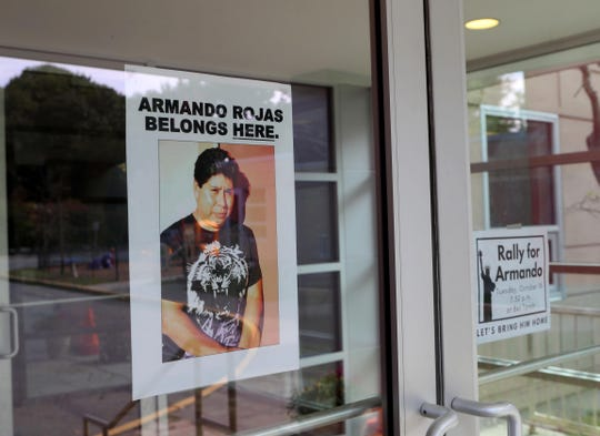 Signs hang on the door Oct. 16, 2018 at the entrance of Bet Torah, a Mount Kisco synagogue, in support of Armando Rojas, who has been the synagogue's custodian for the past twenty years. Rojas, an undocumented Mexican immigrant, was recently detained by ICE and has been in custody for several months. The synagogue will hold a rally tonight as they continue to work for Rojas's release.