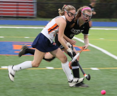 Horace Greeley's Isabelle Klein, left, is pressured by Hackley's Karina Bridge during their game at Greeley Oct. 15, 2018. Greeley won 3-1.