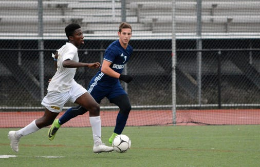 Pelham midfielder Stephan Akichy (left) pushes the ball in transition while Spencer Weinhoff give chase Monday during the first half of a 3-2 win over Byram Hills. He scored the game-winner with three minutes to play.