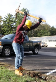 Putnam Northern Westchester BOCES student Ricardo Ac of Peekskill prepares to install post and rail fencing as part of the Urban Forestry and Landscaping Services program, at Caramoor Center for Music and the Arts Oct. 16, 2018 in Katonah. The program prepares the students for jobs in the field by giving them real-life experience in skills like tree-climbing, operating heavy machinery, basic maintenance and installation.