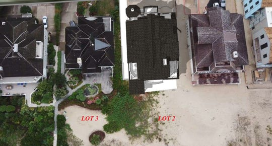 An overhead photograph shows a rendering of the contested, unbuilt home sought by Louis Capano III.