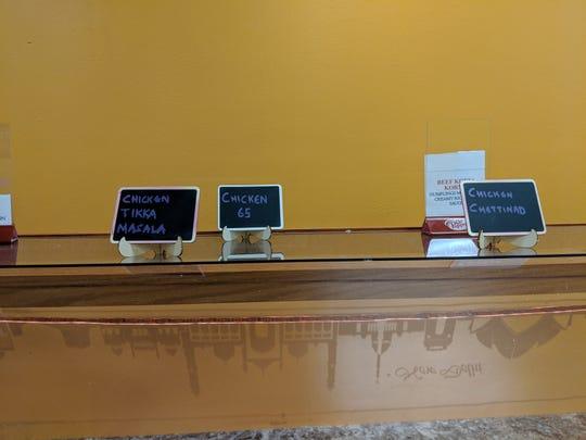 Signs on the buffett at Namaste Indian Restaurant.