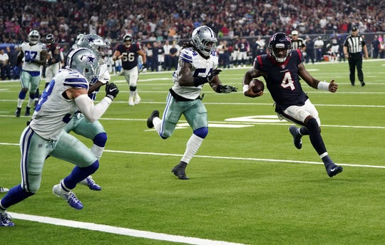 Houston Texans quarterback Deshaun Watson (4) is prevented from scoring by Dallas Cowboys linebacker Jaylon Smith (54) during the first half of an NFL football game, Sunday, Oct. 7, 2018, in Houston.  The play saved a touchdown but Houston went on to win the game.