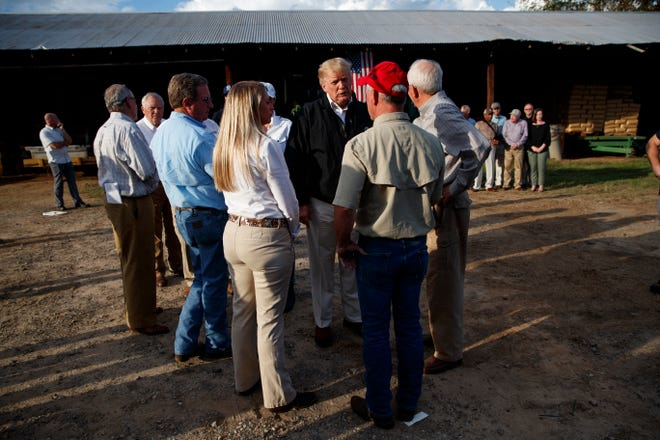 President Donald Trump  meets with farmers impacted by Hurricane Michael, Monday, Oct. 15, 2018, in Macon, Ga.