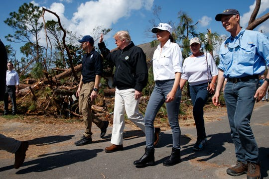 President Donald Trump and first lady Melania Trump tour a neighborhood affected by Hurricane Michael, Monday, Oct. 15, 2018, in Lynn Haven, Fla. From left are FEMA director Brock Long, Trump, the first lady, Margo Anderson, Mayor of Lynn Haven, Fla., and Florida Gov. Rick Scott, right.