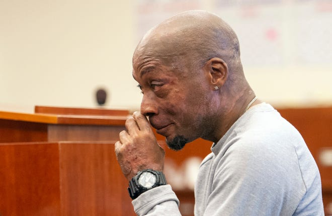 FILE - In this Aug. 10, 2018 file photo, Dewayne Johnson reacts after hearing the verdict in his case against Monsanto at the Superior Court of California in San Francisco. Jurors who found that agribusiness giant Monsanto's Roundup weed killer contributed to the school groundskeeper's cancer are urging a San Francisco judge not to throw out the bulk of their $289 million award in his favor, a newspaper reported Monday, Oct. 15.