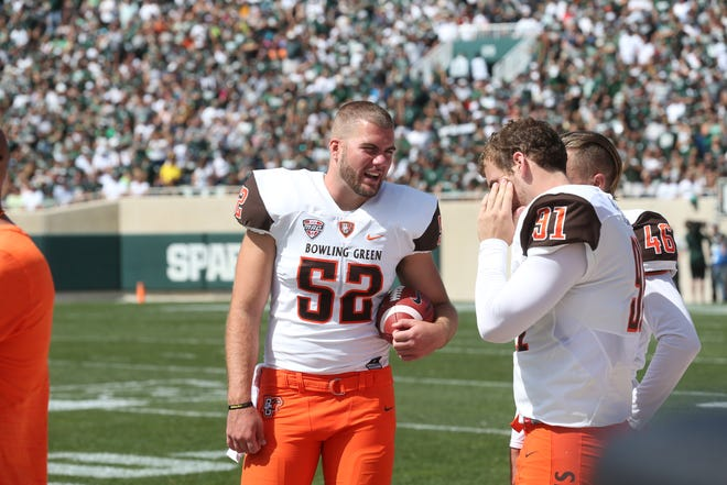 Bowling Green sophomore long snapper Gabe Skrobot talks with teammates during a game from last season. The Rosecrans graduate is a nominee for the 2018 Wuerffel Trophy, which is College Football's Premier Award for Community Service.