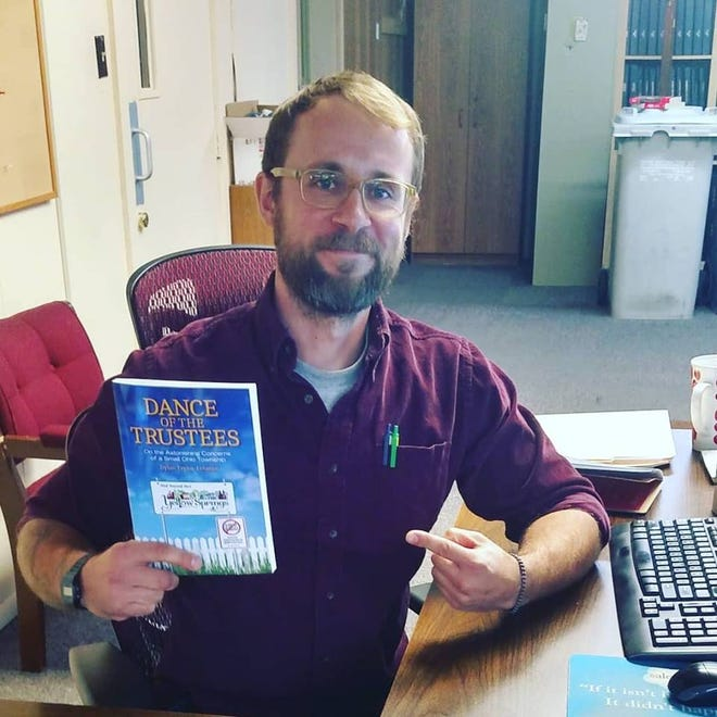 """Dylan Taylor-Lehman of Zanesville with his new book """"Dance of the Trustees."""""""