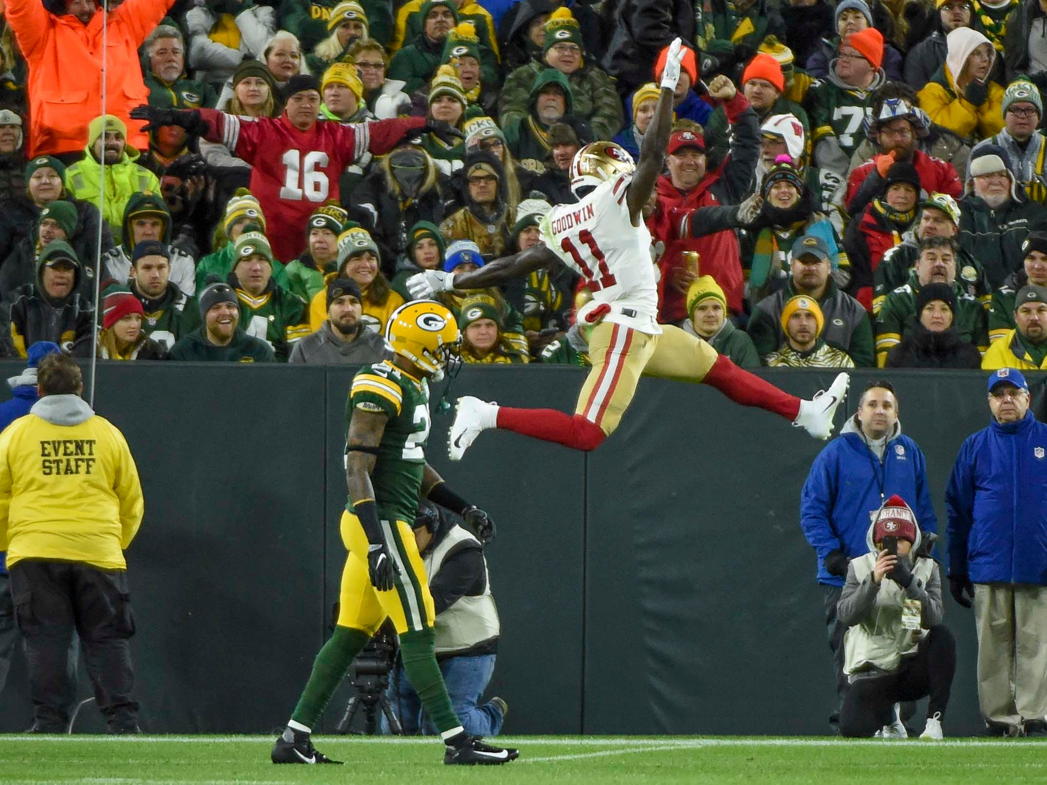 San Francisco 49ers wide receiver Marquise Goodwin celebrates in front of Green Bay Packers safety Ha Ha Clinton-Dix after scoring a touchdown in the second quarter at Lambeau Field.