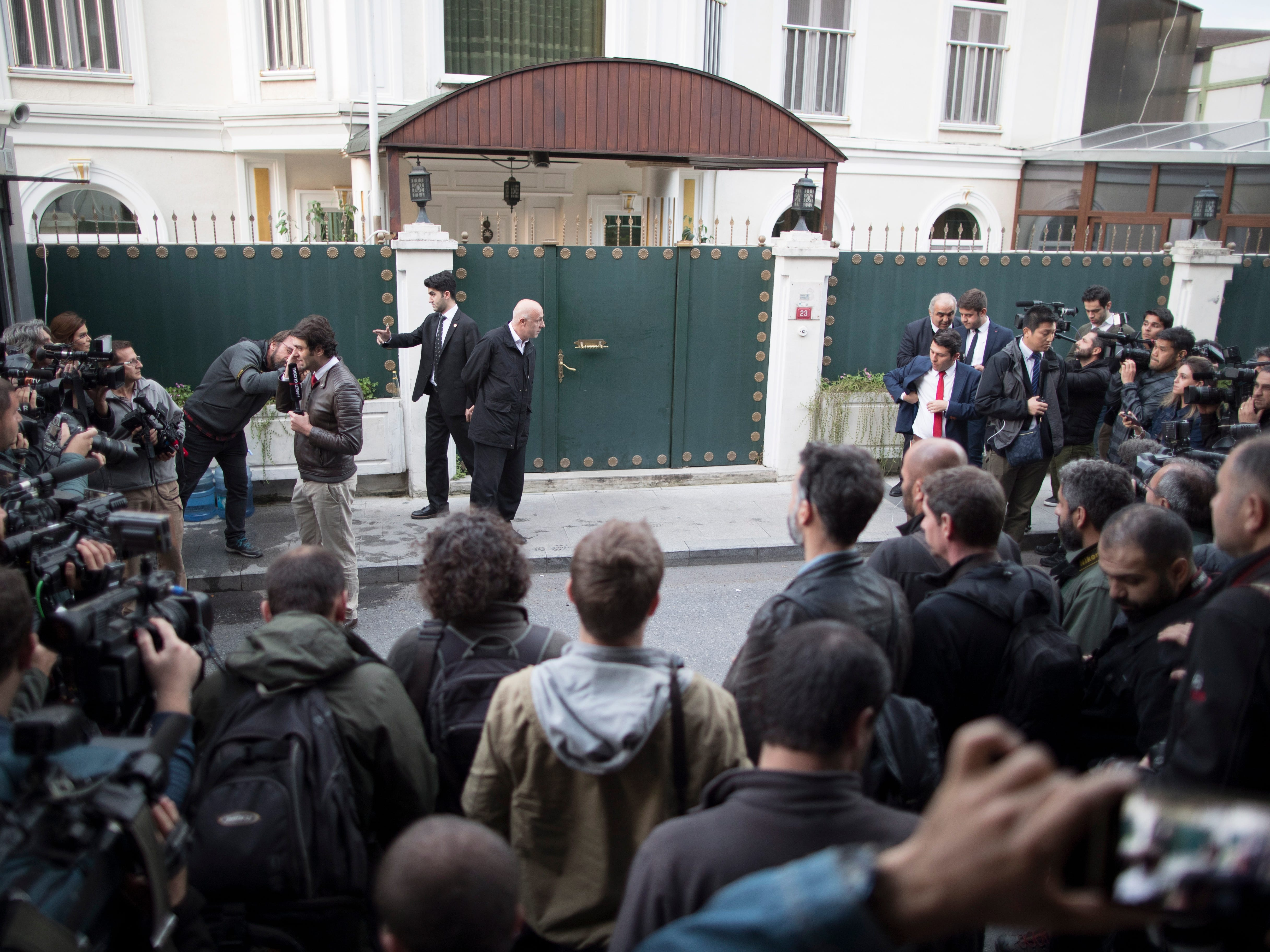 Turkish forensic police officers arrive for an investigation at the residence of the Saudi consul in Istanbul, Oct. 16, 2018.
