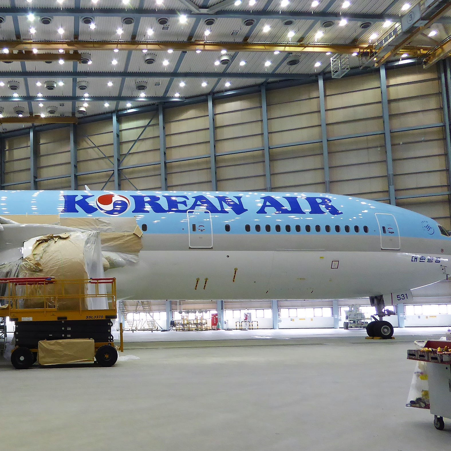 A Korean Air 777-200 plane being painted in the airline's paint hangar in Busan, South Korea.
