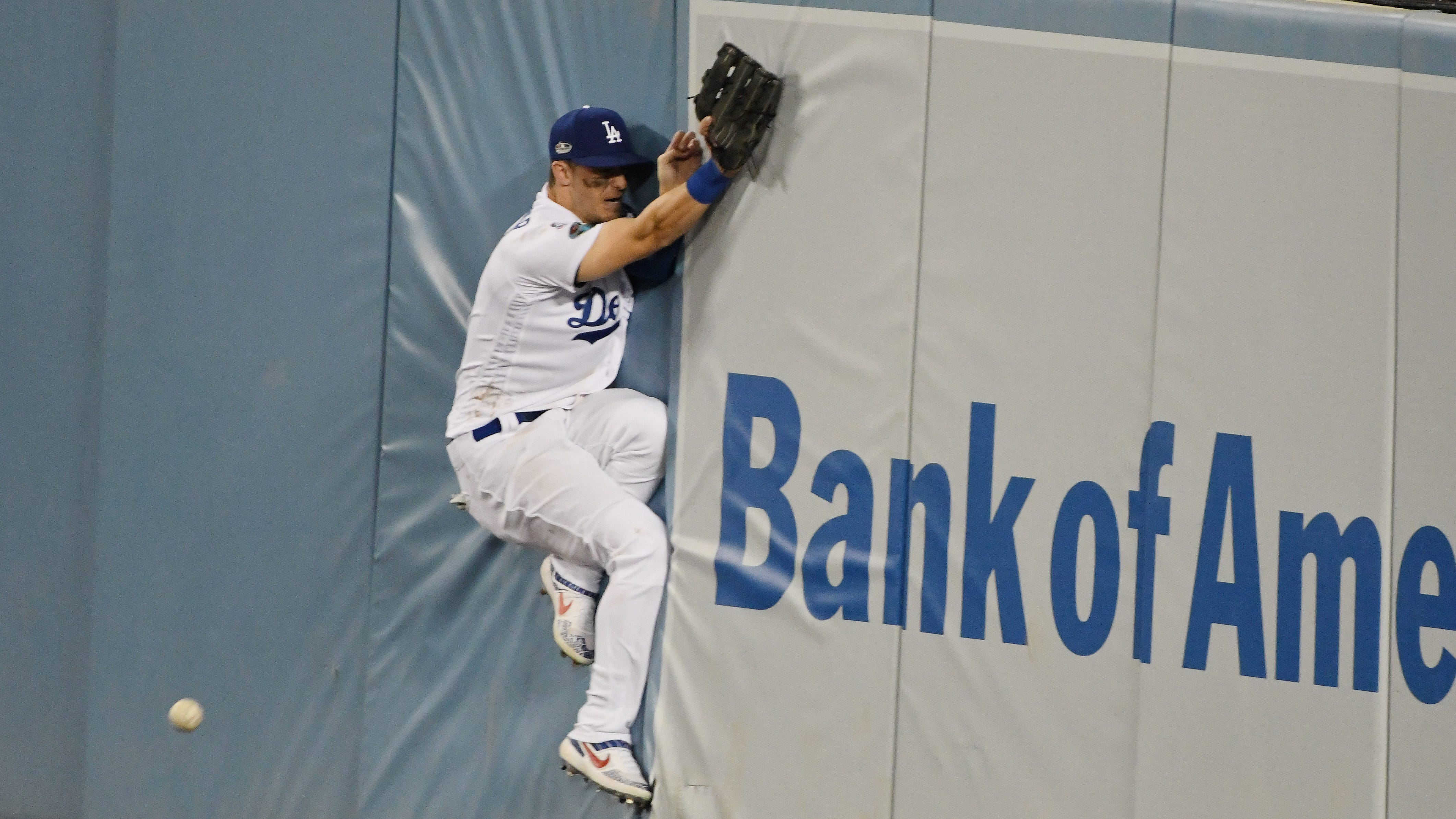 Dodgers center fielder Cody Bellinger fails to make a catch against the Milwaukee Brewers in Game 3 of the 2018 NLCS series at Dodger Stadium.