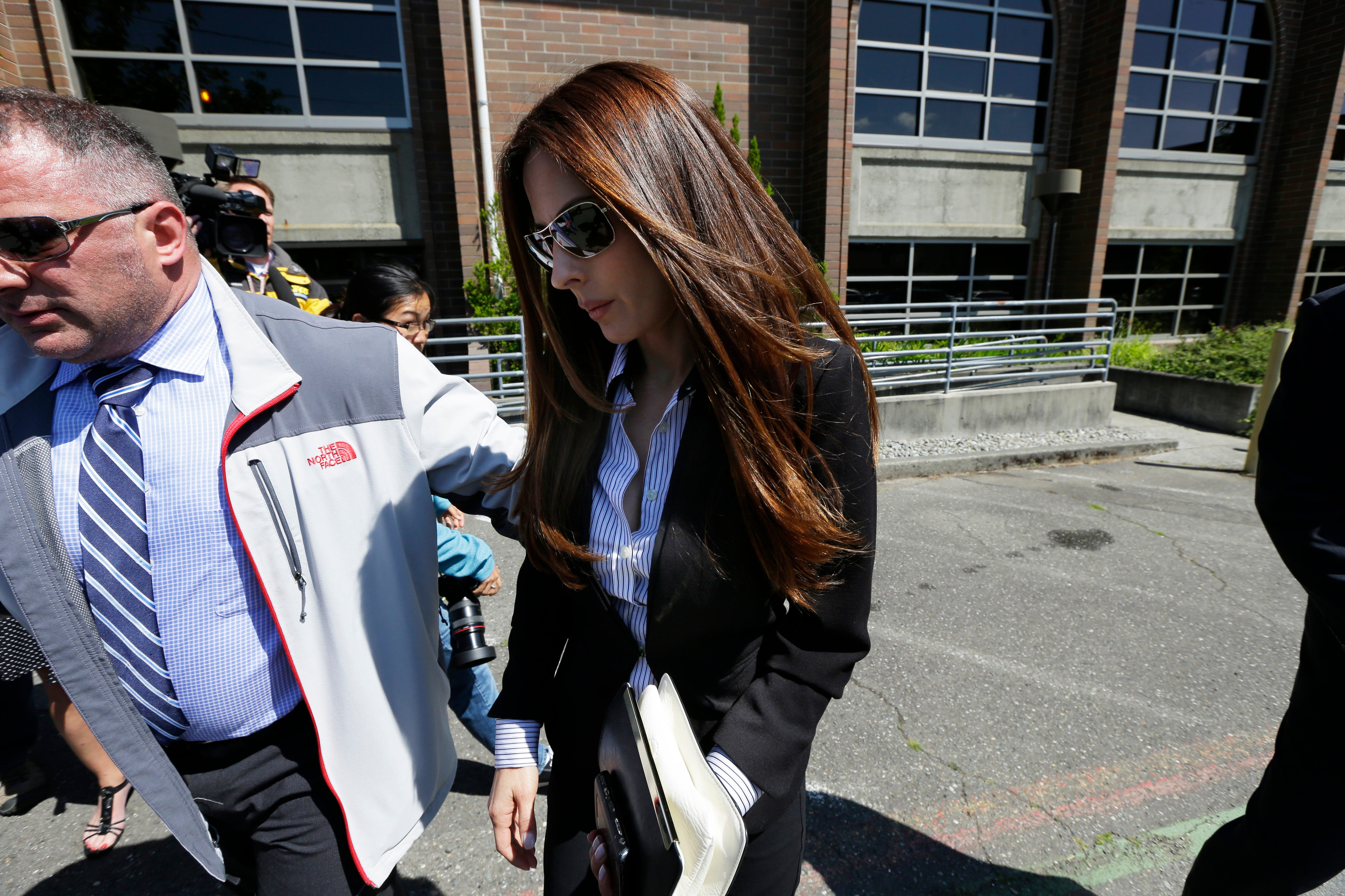 Kerri Kasem, the daughter of radio personality Casey Kasem, leaves the Kitsap County Courthouse in Port Orchard, Wash., on Friday, May 30, 2014.