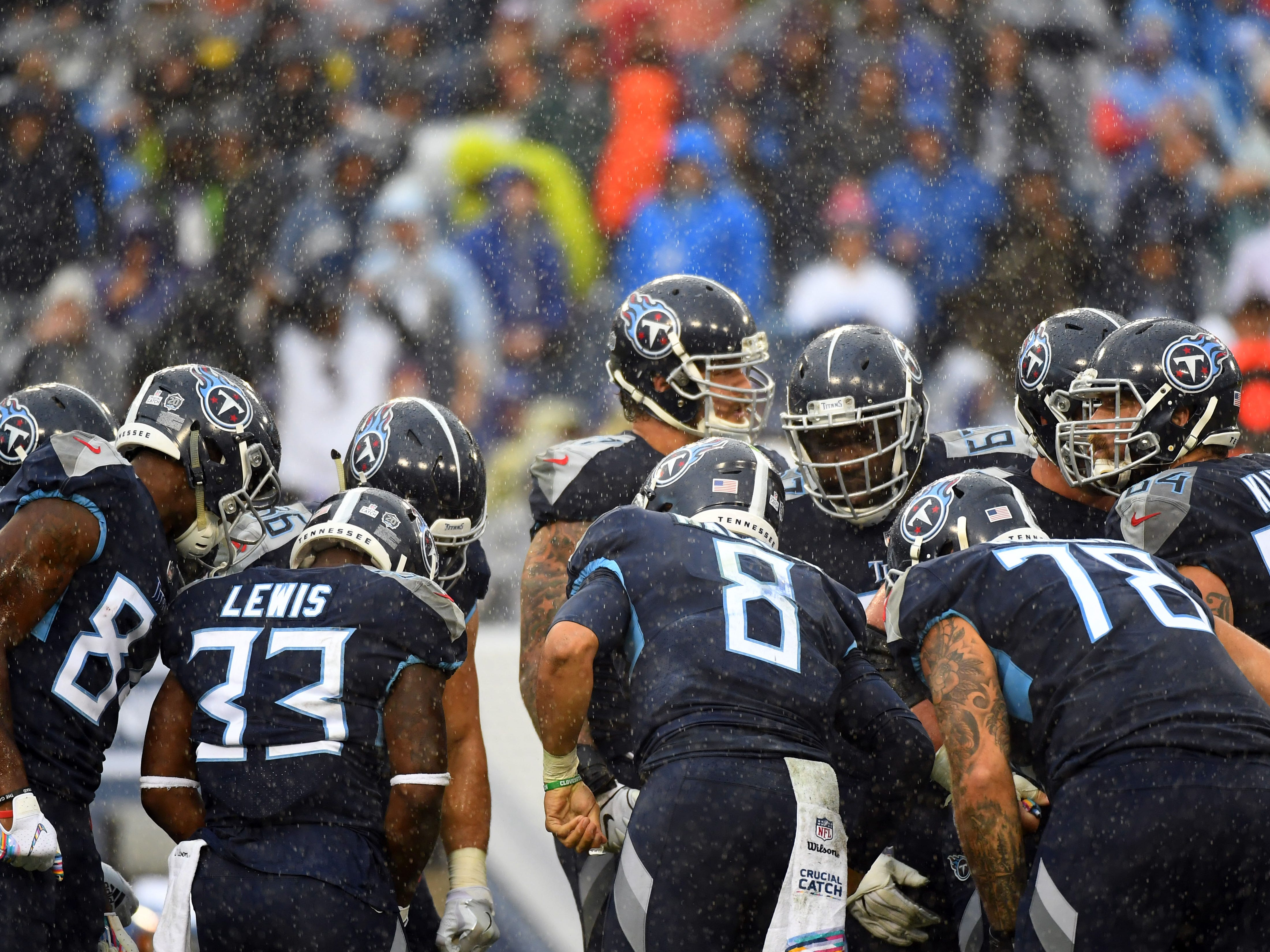 Week 6: Rain falls as Tennessee Titans quarterback Marcus Mariota (8) talks in the huddle during the first half against the Baltimore Ravens at Nissan Stadium. The Ravens won the game, 21-0.