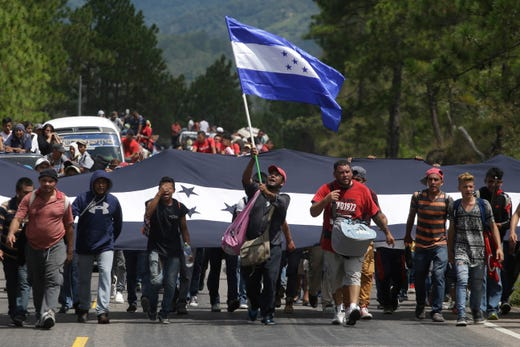 Hondurans march in a caravan of migrants moving toward the country's border with Guatemala in a desperate attempt to flee poverty and seek new lives in the United States, in Ocotepeque, Honduras, Monday, Oct. 15, 2018. The group has grown to an estimated 1,600 people from an initial 160 who first gathered early Friday in a northern Honduras city. They plan to try to enter Guatemala on Monday. (AP Photo/Moises Castillo) ORG XMIT: XMC106