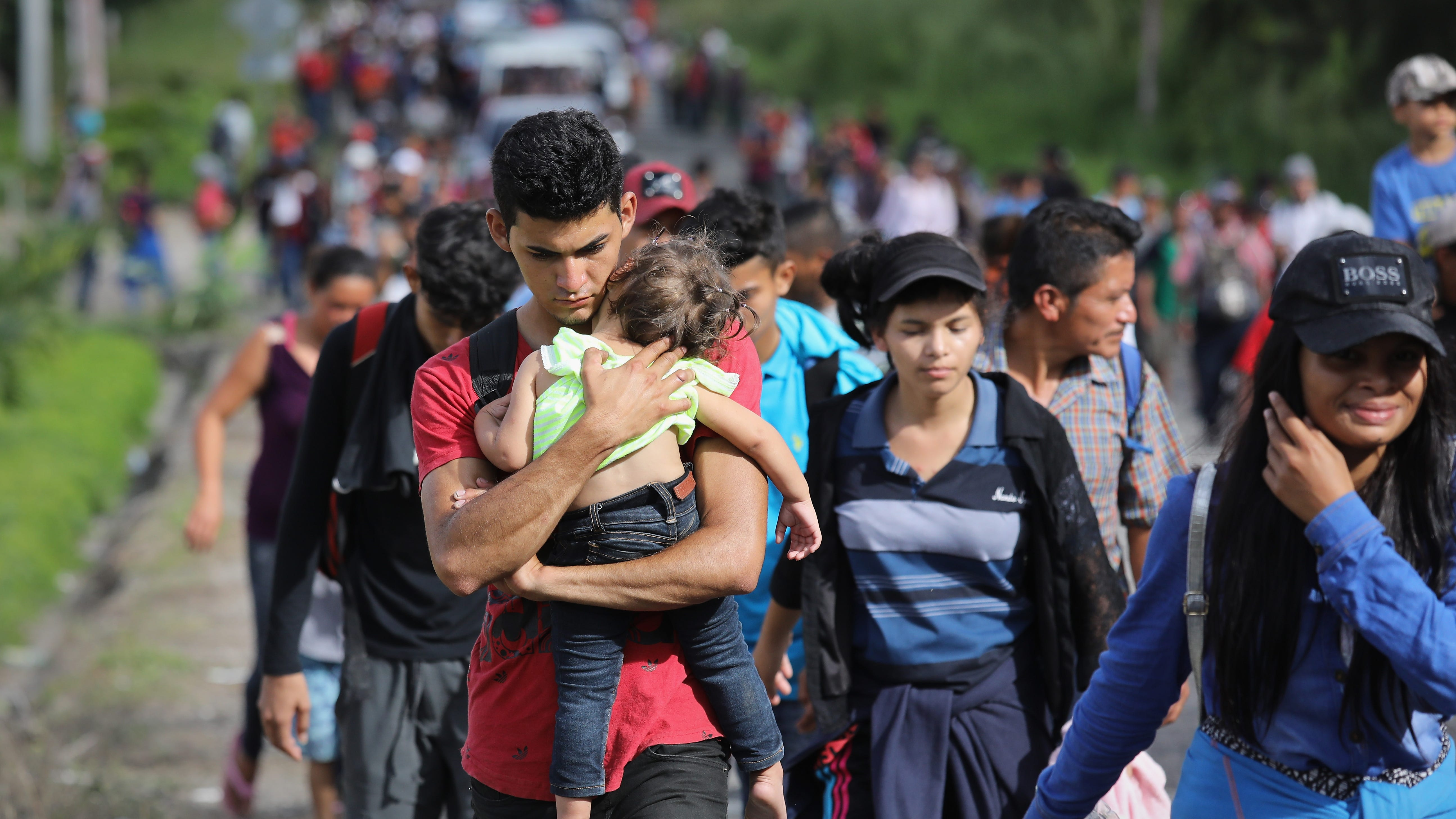 A caravan of more than 1,500 Honduran migrants moves north after crossing the border from Honduras into Guatemala on Oct. 15, 2018 in Esquipulas, Guatemala.