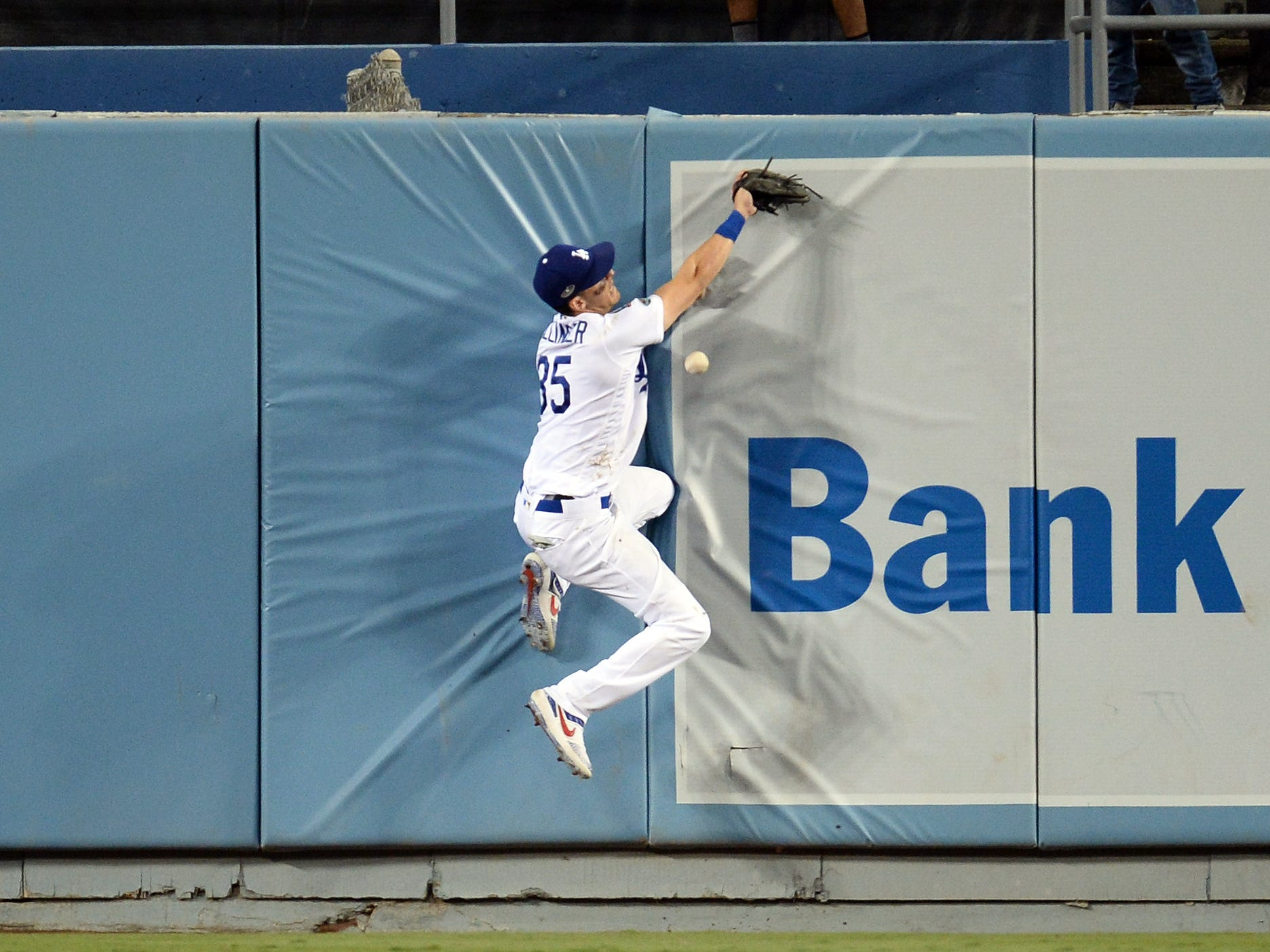 NLCS Game 3: Dodgers center fielder Cody Bellinger can't make a catch on a ball off the bat of Brewers second baseman Travis Shaw in the sixth inning.