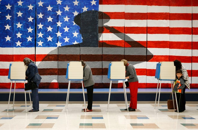 Voters line up in voting booths to cast their ballots at Robious Elementary School in Richmond, Virginia, Nov. 8, 2016.