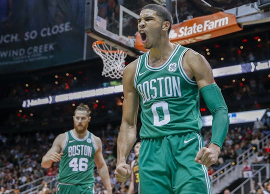Jayson Tatum reacts after a dunk against the Atlanta Hawks.