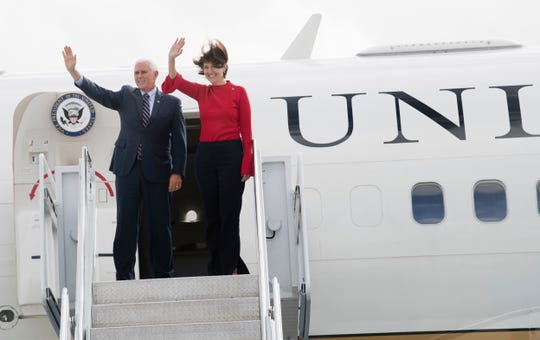 Vice President Mike Pence exits Air Force Two after visiting with Republican U.S. Rep. Cathy McMorris Rodgers  at Signature Flight Support at Spokane International Airport Oct. 2, 2018, in Spokane, Wash. Pence came to downtown Spokane to stump for McMorris Rodgers, who faces a strong challenge this year from Democrat Lisa Brown.