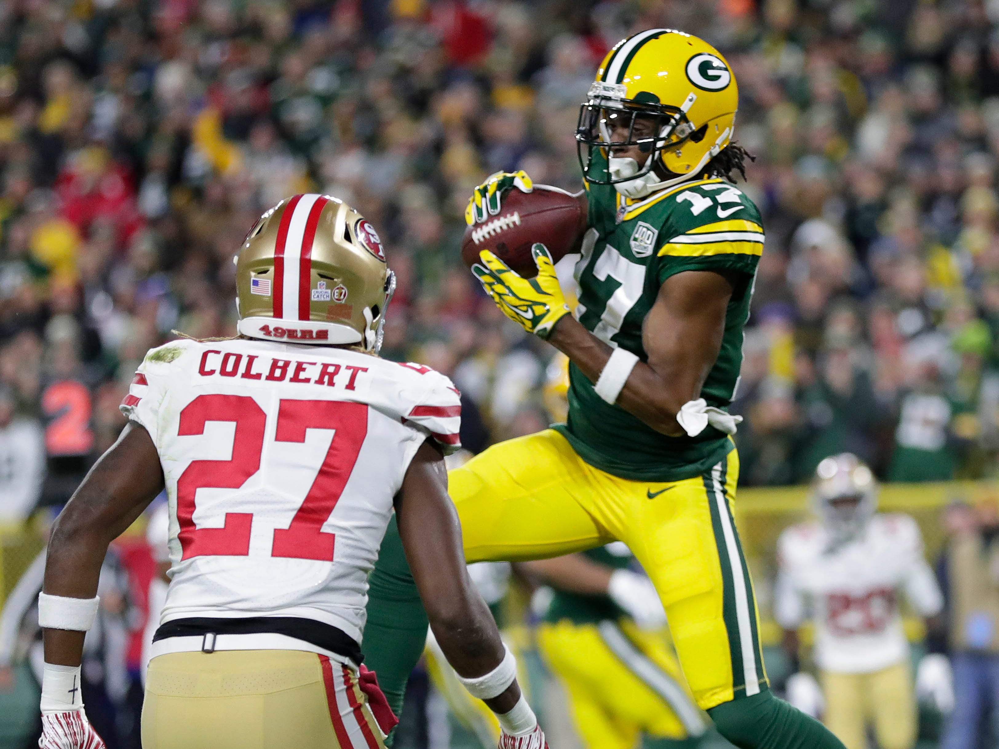 Green Bay Packers wide receiver Davante Adams scores a touchdown against the San Francisco 49ers at Lambeau Field.
