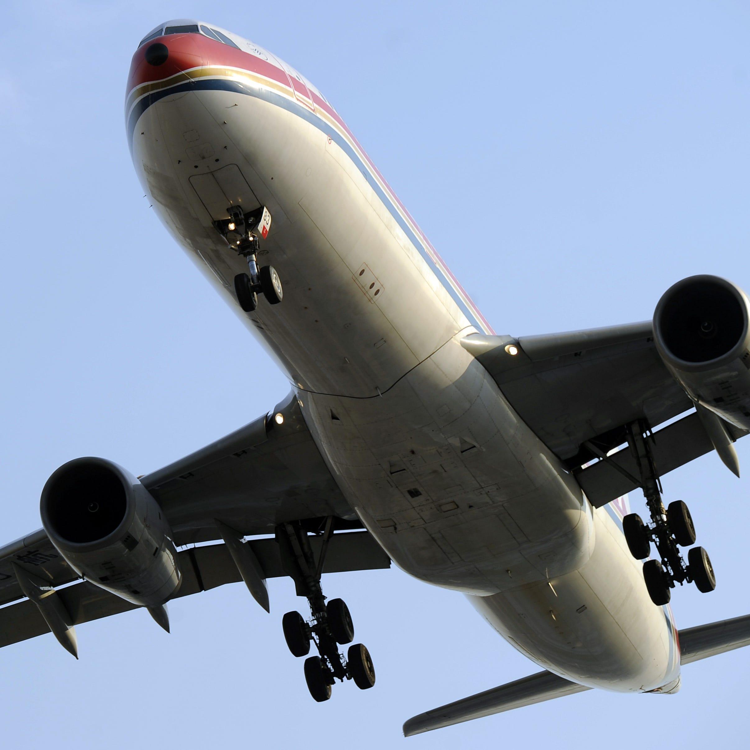 An airliner flies into Hongqiao International airport in Shanghai on Jan. 5, 2012.