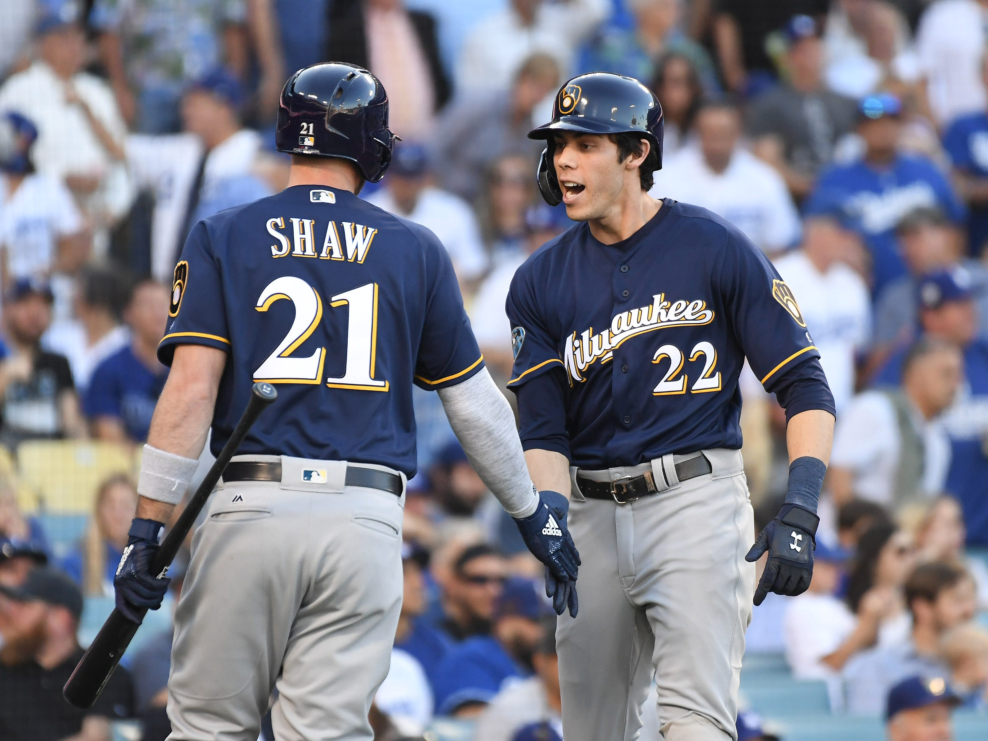NLDS Game 3: Brewers right fielder Christian Yelich scores on on an double by left fielder Ryan Braun in the first inning.