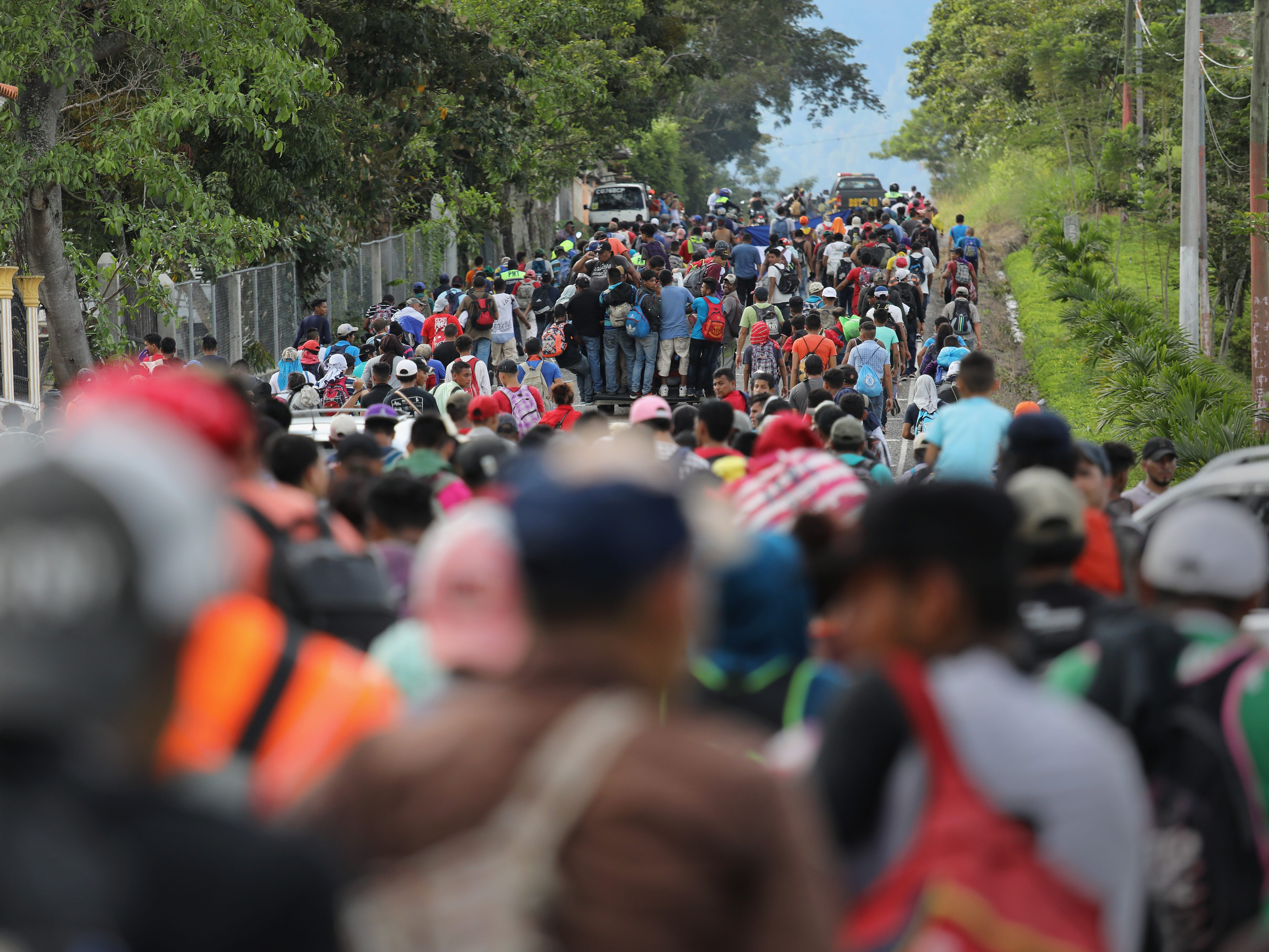 ESQUIPULAS, GUATEMALA - OCTOBER 15:  A caravan of more than 1,500 Honduran migrants moves north after crossing the border from Honduras into Guatemala on October 15, 2018 in Esquipulas, Guatemala. The caravan, the second of 2018, began Friday in San Pedro Sula, Honduras with plans to march north through Guatemala and Mexico en route to the United States. Honduras has some of the highest crime and poverty rates in Latin America.  (Photo by John Moore/Getty Images) ORG XMIT: 775243532 ORIG FILE ID: 1052219378