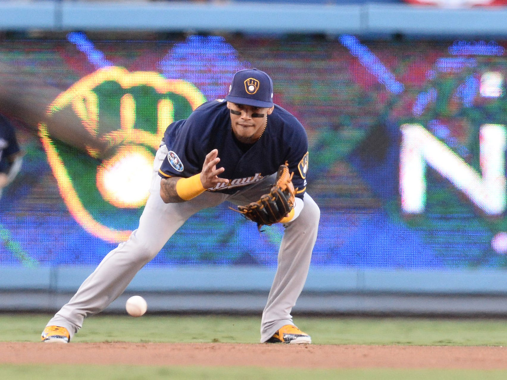 NLDS Game 3: Brewers shortstop Orlando Arcia fields a ball in the first inning.