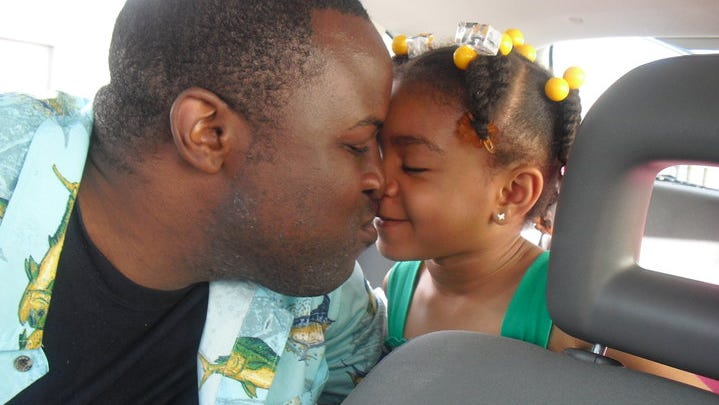 Chinedu Valentine Okobi with his daughter in 2010