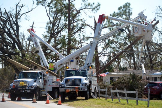 Oct. 15, 2018, Panama City, FL, USA; Linemen from all over the country work 24 hours a day to restore power to the grid in the Florida Panhandle ravaged by Hurricane Michael. Mandatory Credit: Patrick Dove/Treasure Coast News via USA TODAY NETWORK  (Via OlyDrop)
