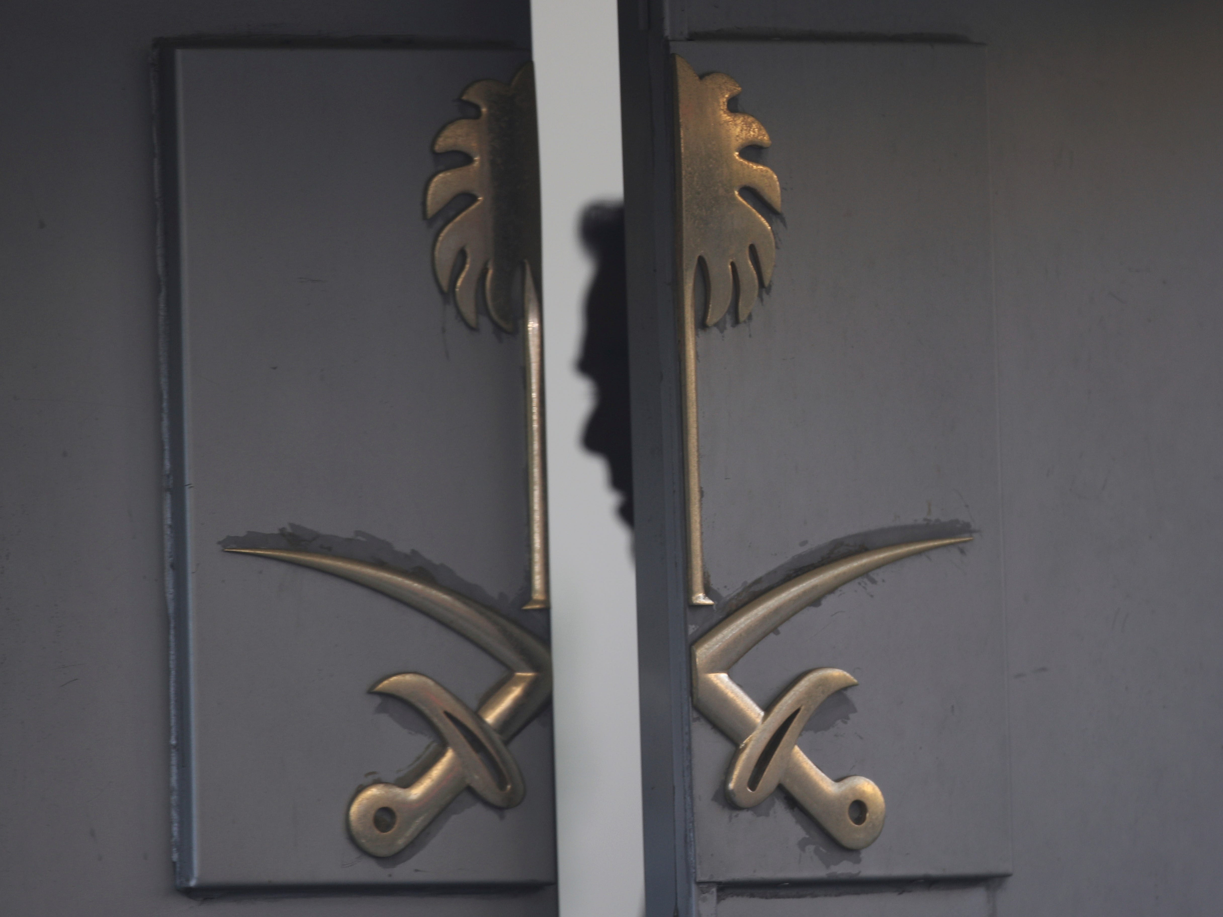 A security member is seen inside the entrance of the Saudi Arabia's Consulate in Istanbul, Tuesday, Oct. 16, 2018. A Turkish forensics teams finished a search for evidence inside the Saudi Arabia Consulate in Istanbul early Tuesday morning, over the disappearance and alleged slaying of Saudi writer Jamal Khashoggi.