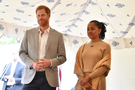 Prince Harry and his mother-in-law, Doria Ragland of Los Angeles, at a reception at Kensington Palace to launch a cookbook sponsored by his wife, Duchess Meghan of Sussex, on Sept. 20, 2018 in London.