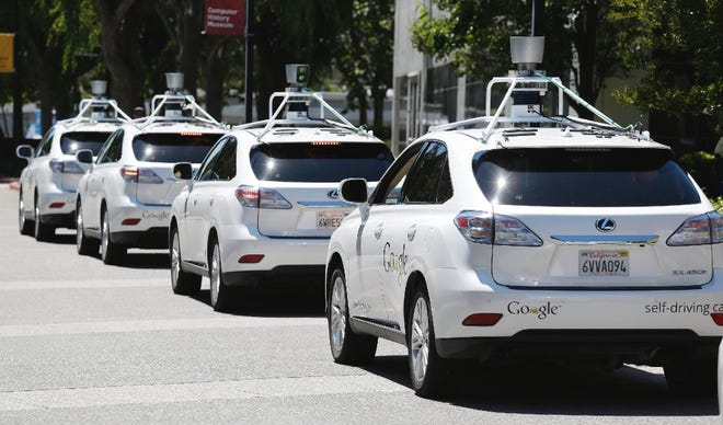 A row of Google self-driving cars outside the Computer History Museum in Mountain View, Calif., 2014
