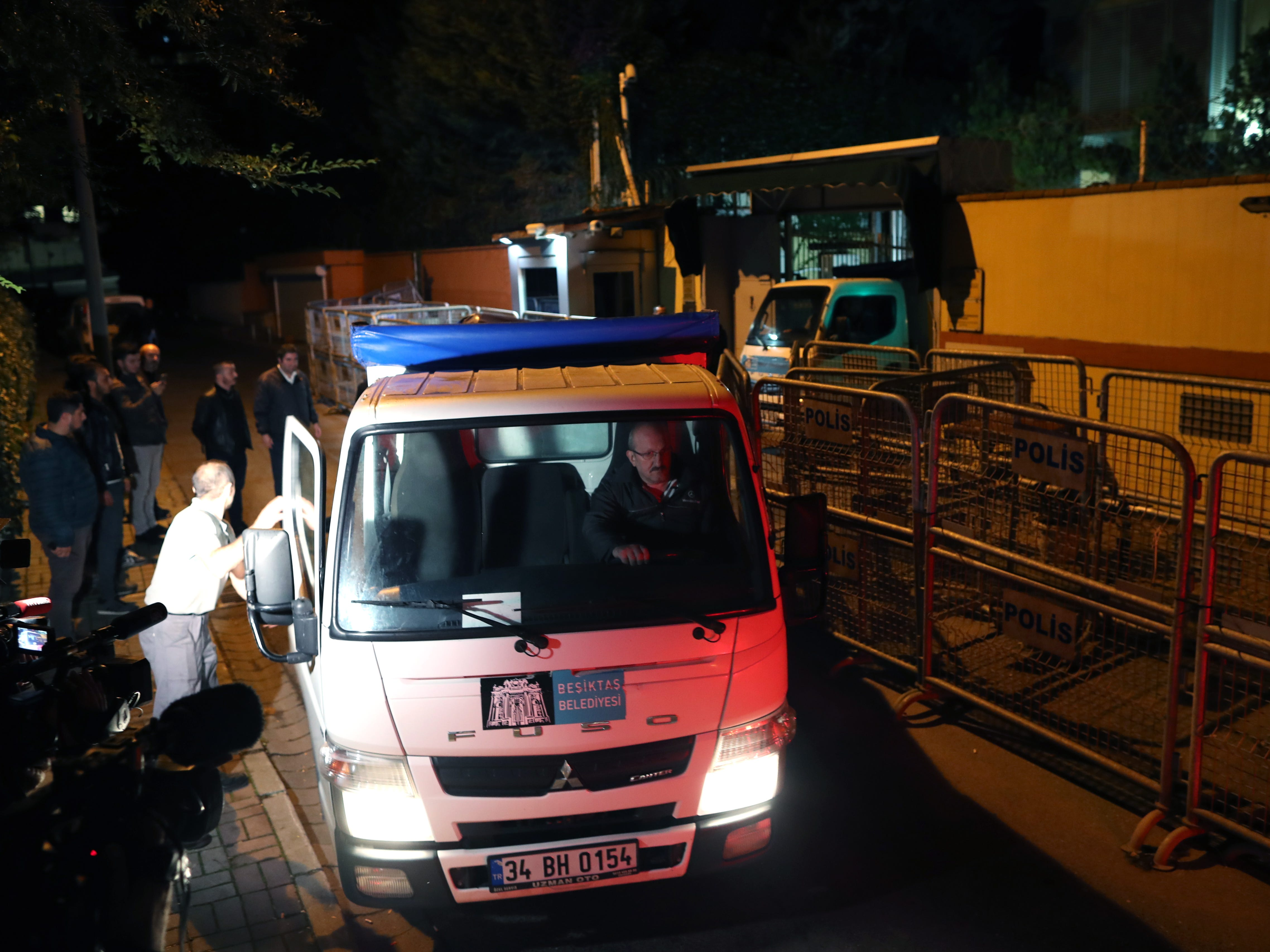 Two trucks are loaded with evidence from Turkish forensic police officers as they take part in the investigation of the disappearance of journalist Jamal Khashoggi, at the Saudi Consulate in Istanbul, Oct. 16, 2018.