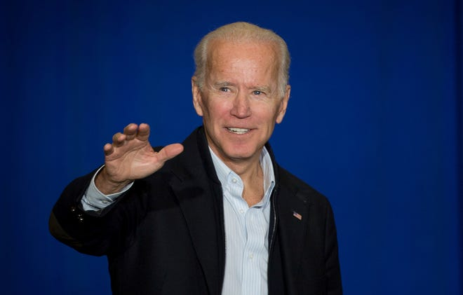 Former Vice President Joe Biden wave to supporters during a campaign event for democratic congressional candidate Amy McGrath in Owingsville, Ky., Oct. 12, 2018.