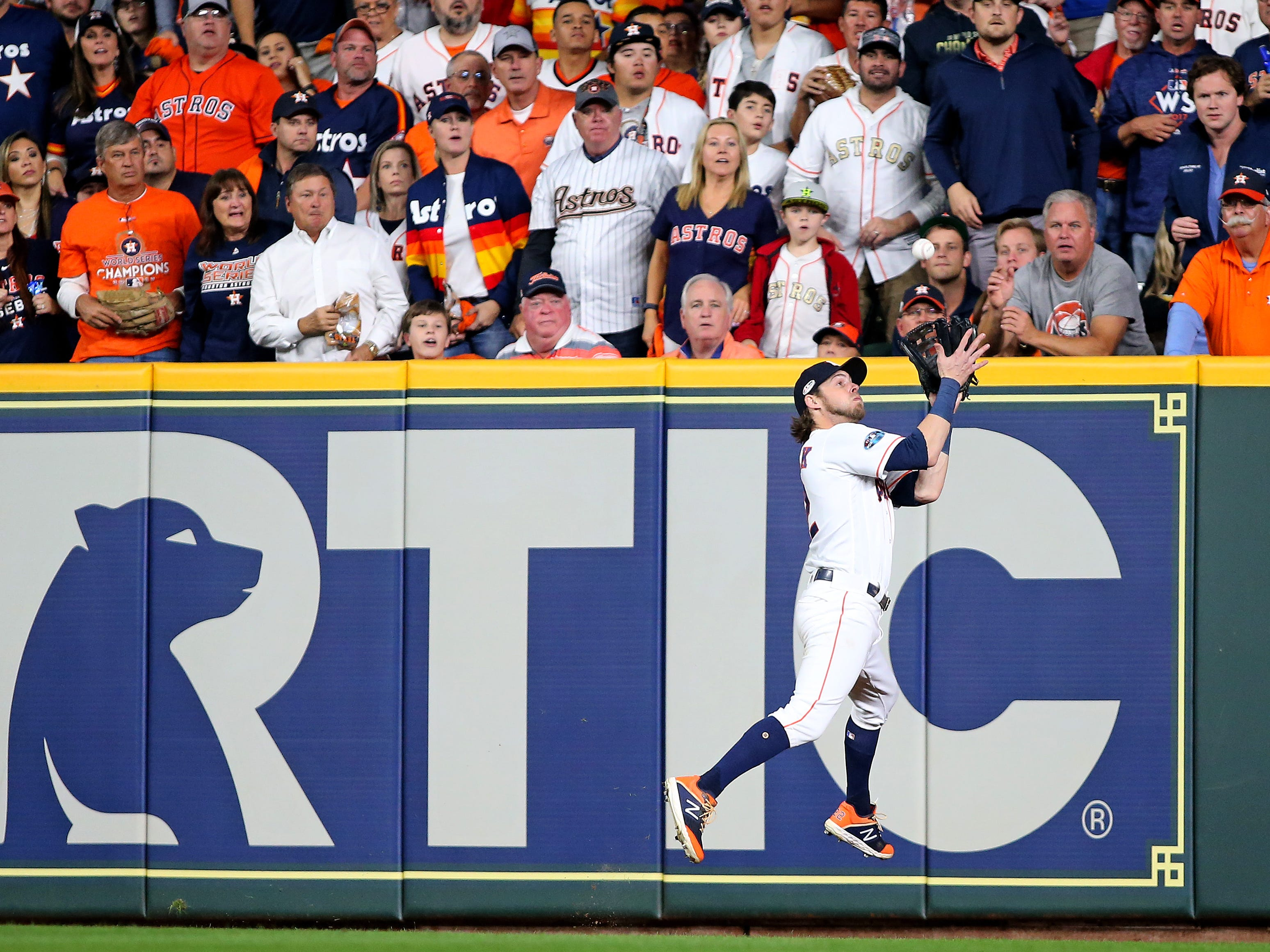 ALCS Game 3: Astros right fielder Josh Reddick makes an impressive catch for an out in the fourth inning.