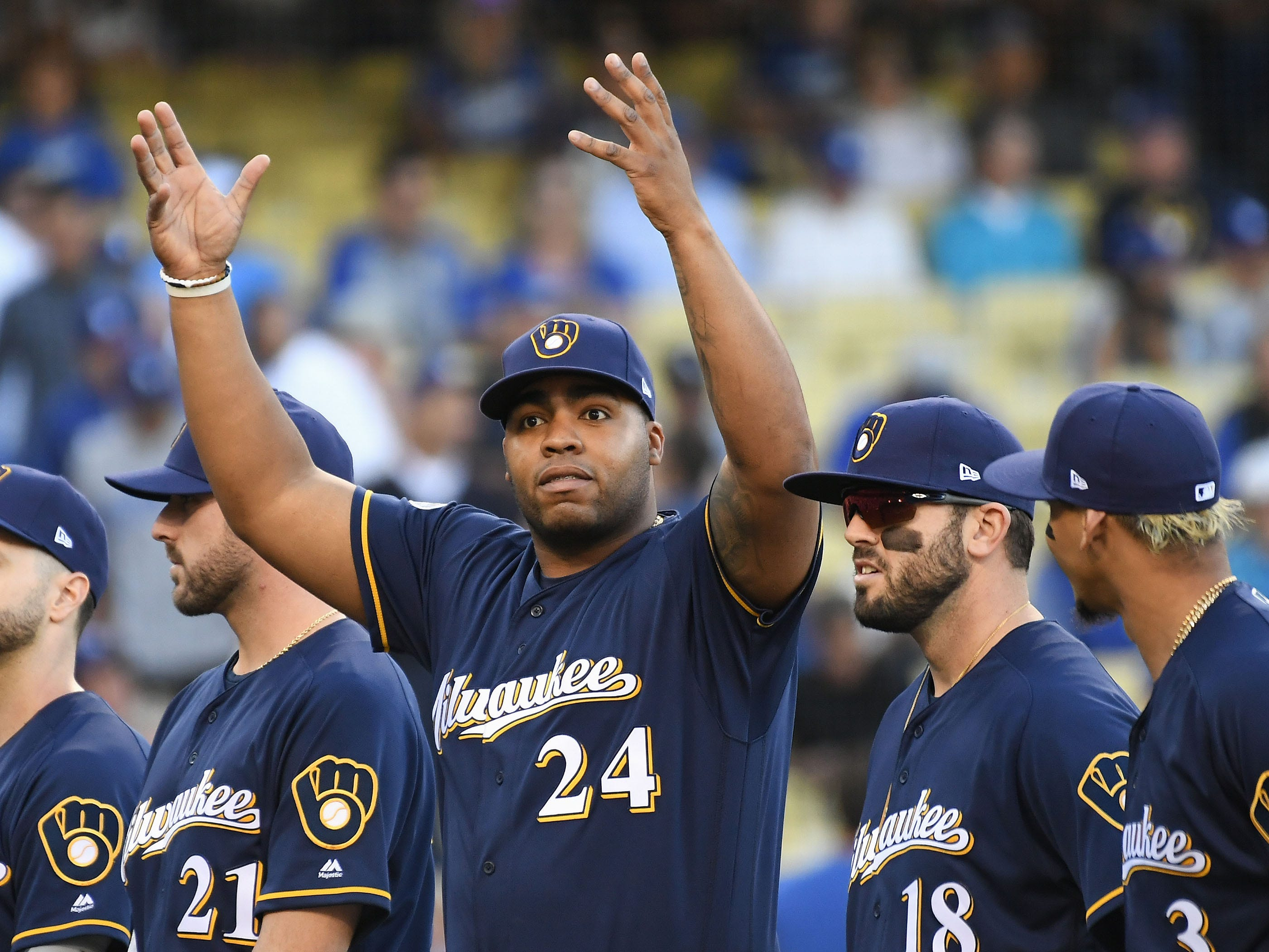 NLCS Game 3: Brewers first baseman Jesus Aguilar reacts to the crowd during pregame introductions.