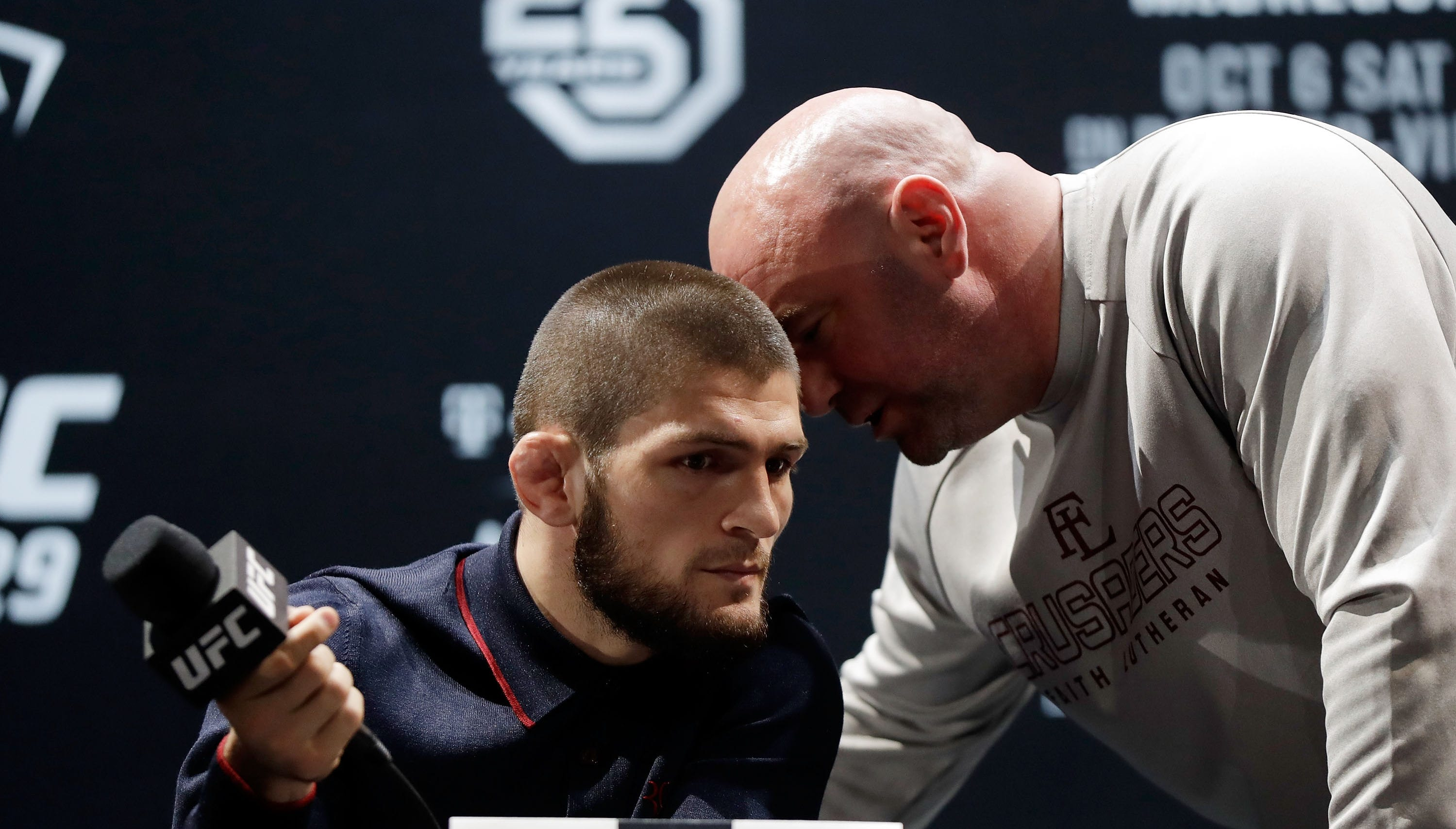 UFC President Dana White speaks with Khabib Nurmagomedov during a press conference for UFC 229.