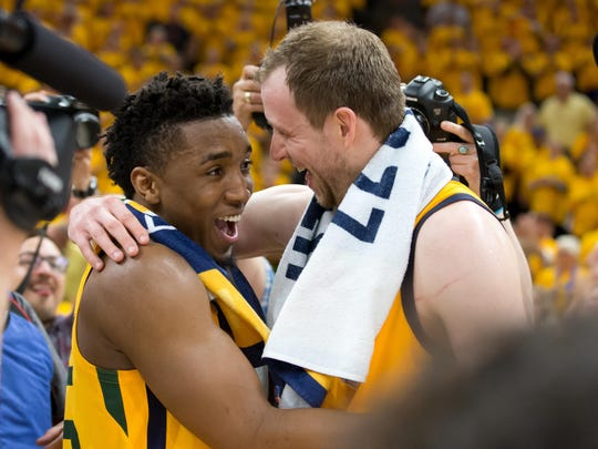 Donovan Mitchell and Joe Ingles react after a series-clinching win against the Oklahoma City Thunder.