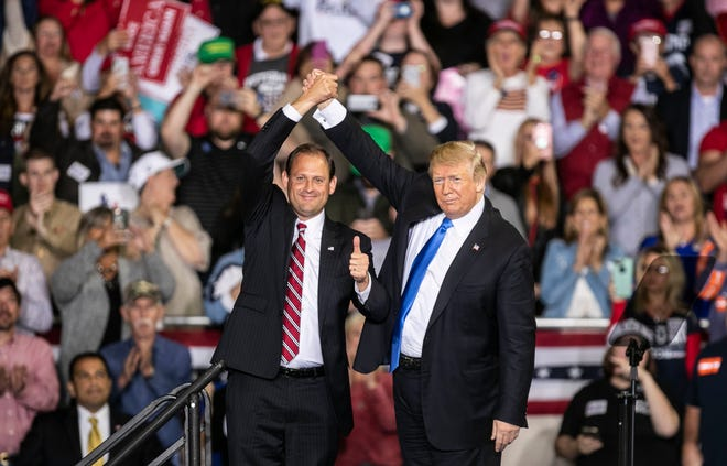 President Donald Trump urges the crowd to vote for Republican Kentucky representative Andy Barr at the conclusion of his speech on the Eastern Kentucky University campus.