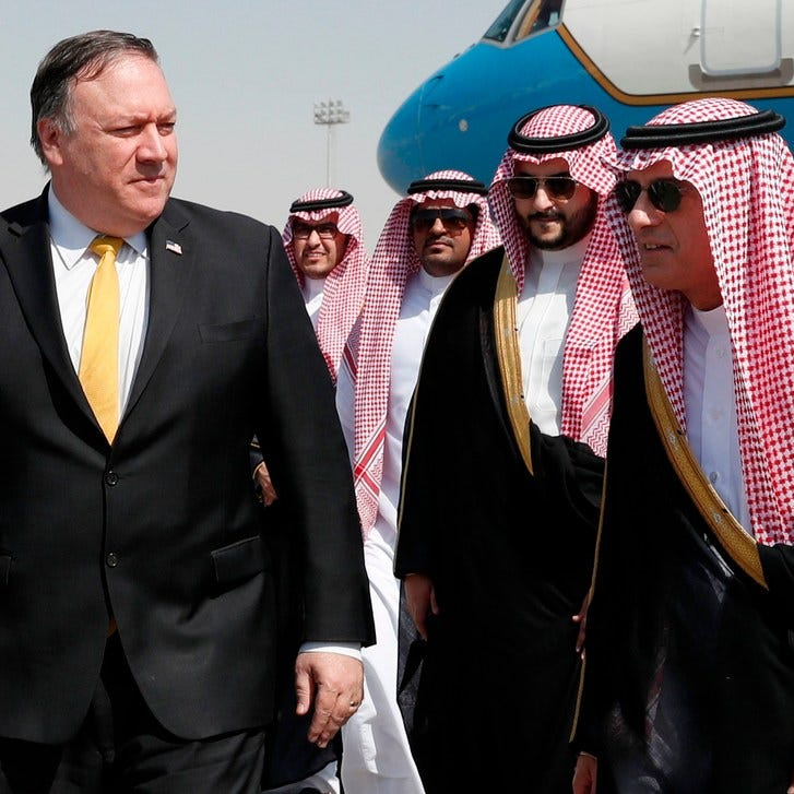 Secretary of State Mike Pompeo, left, walks alongside Saudi Foreign Minister Adel al-Jubeir after arriving in Riyadh, on October 16, 2018.