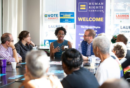 Human Rights Campaign President Chad Griffin and Democratic candidate Lauren Underwood for Illinois' 14th Congressional District candidate listen during a LGBTQ Roundtable after her endorsement on Wednesday, Oct. 3, 2018 in Geneva, Ill.