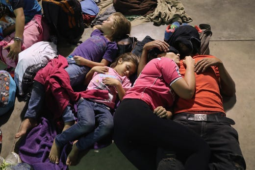 ESQUIPULAS, GUATEMALA - OCTOBER 15:  Honduran immigrants overnight at an migrant shelter on October 15, 2018 in Esquipulas, Guatemala. A caravan of at least 1,500 Central Americans, the second of its kind in 2018, began in San Pedro Sula, Honduras with plans to march north through Guatemala and Mexico in route to the United States. Honduras has some of the highest crime and poverty rates in Latin America.  (Photo by John Moore/Getty Images) ORG XMIT: 775243532 ORIG FILE ID: 1052270796