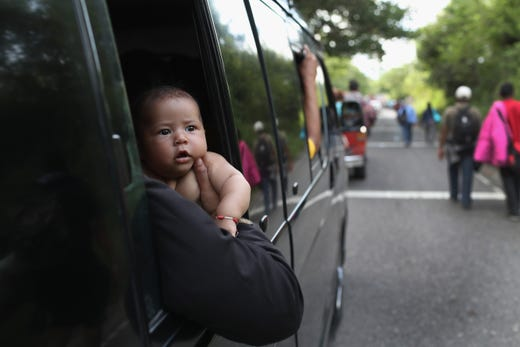 ESQUIPULAS, GUATEMALA - OCTOBER 15:  A caravan of more than 1,500 Honduran migrants moves north after crossing the border from Honduras into Guatemala on October 15, 2018 in Esquipulas, Guatemala. The caravan, the second of 2018, began Friday in San Pedro Sula, Honduras with plans to march north through Guatemala and Mexico en route to the United States. Honduras has some of the highest crime and poverty rates in Latin America.  (Photo by John Moore/Getty Images) ORG XMIT: 775243532 ORIG FILE ID: 1052219454