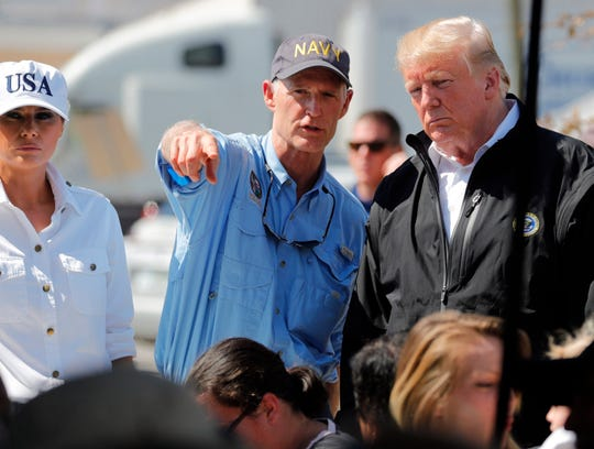 President Trump and Florida Gov. Rick Scott, left, visit Lynn Haven, Fla.