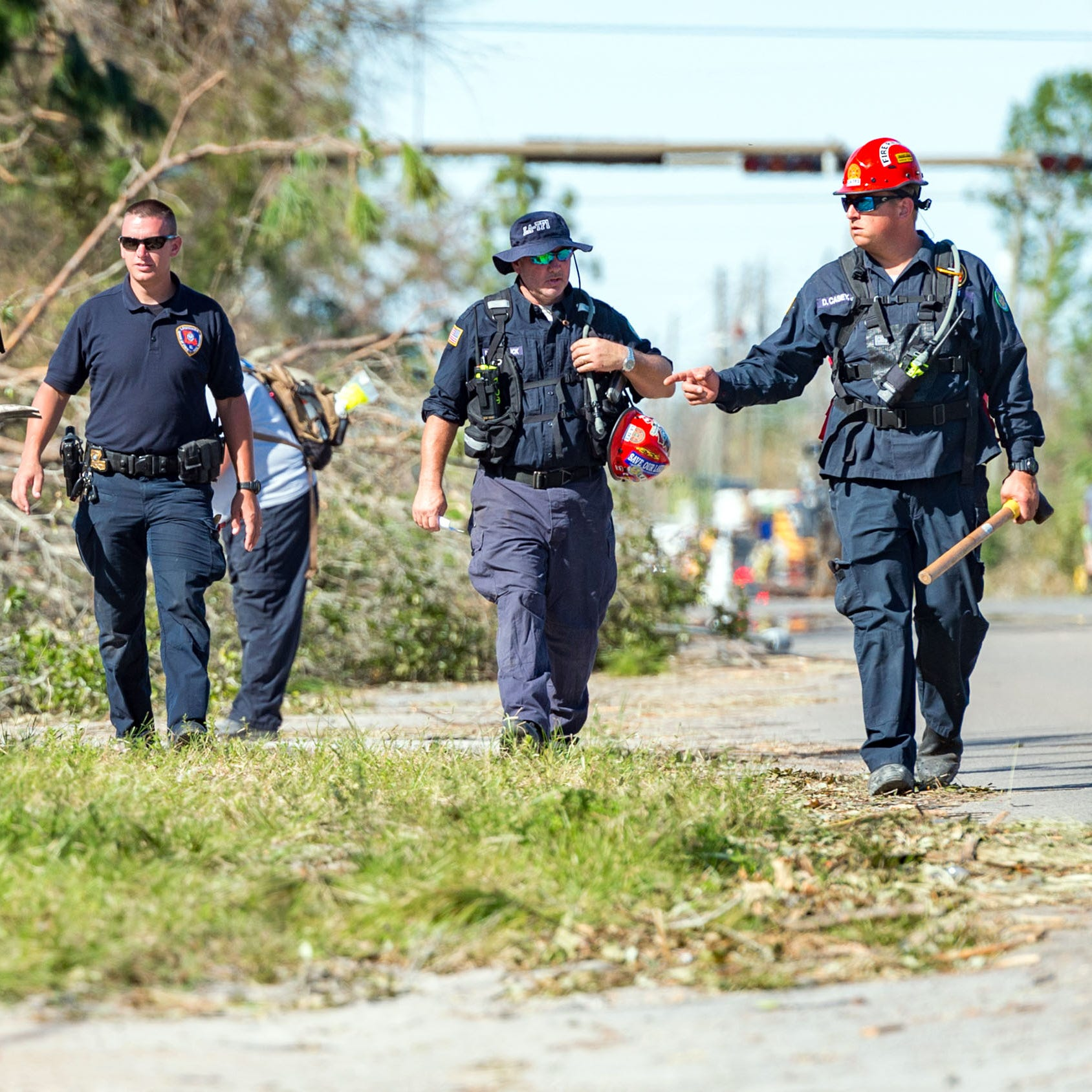 Firefighters from Jefferson Parish, La., perform search and rescue in neighborhoods around Panama City, Fla., Friday, Oct. 12, 2018.
