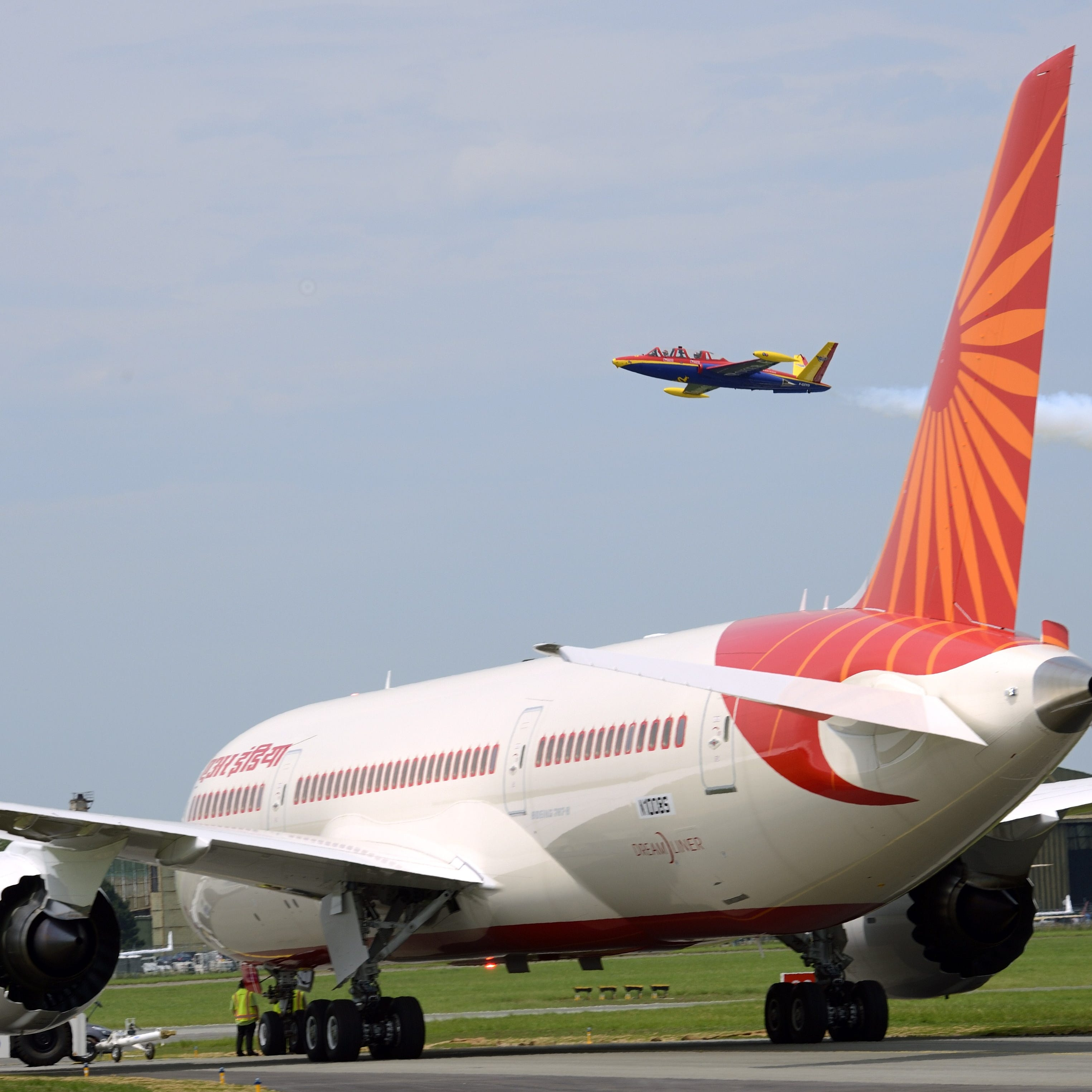 An Air India flight attendant injured her legs when she fell to the tarmac after trying to close the door on a Boeing 777.