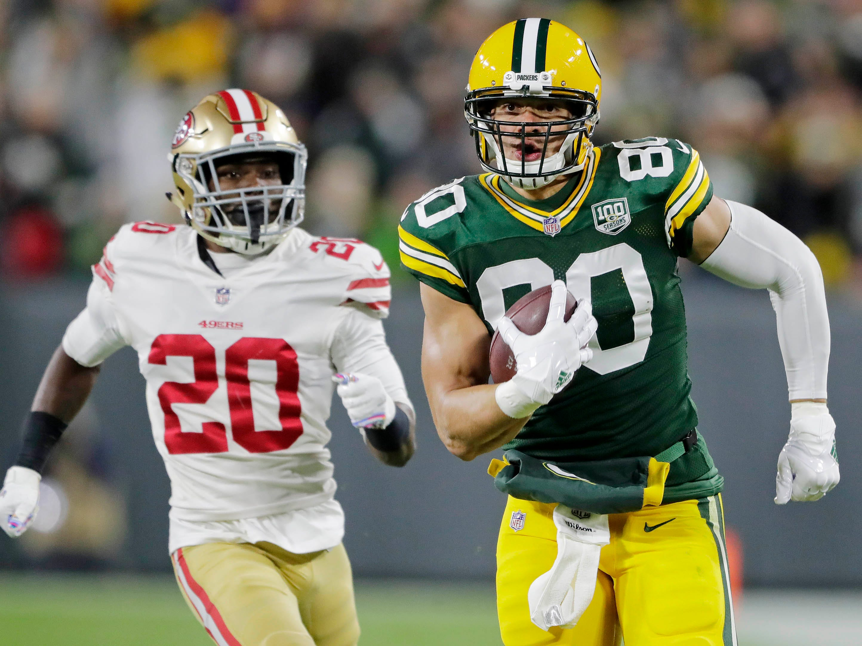 Green Bay Packers tight end Jimmy Graham runs after a catch against the San Francisco 49ers in the first quarter  at Lambeau Field.