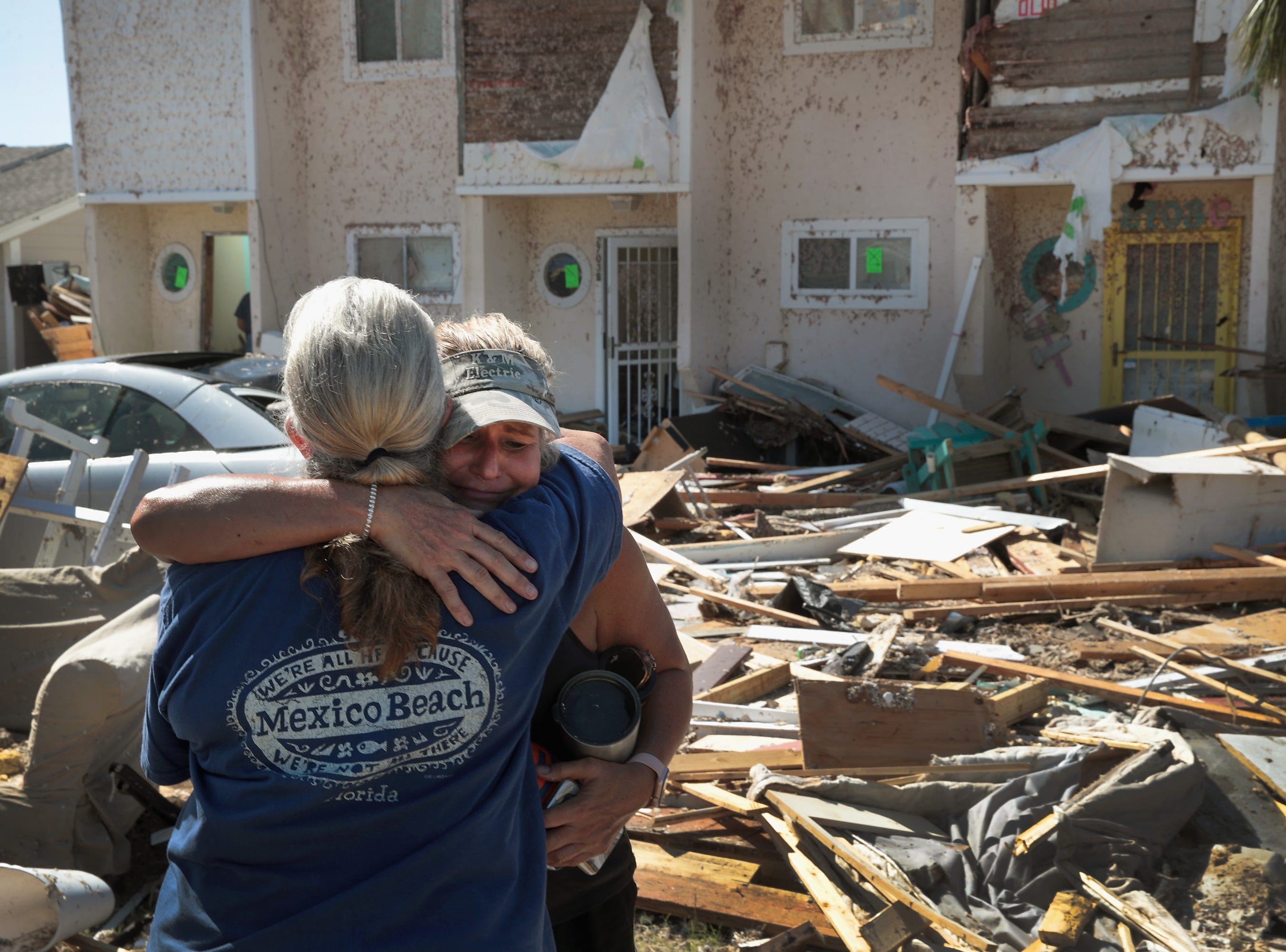 Neighbors Sherry Frantz, left, and Chris McNeal hug as they meet in front of their homes which were destroyed by Hurricane Michael on Oct. 16, 2018 in Mexico Beach, Fla.